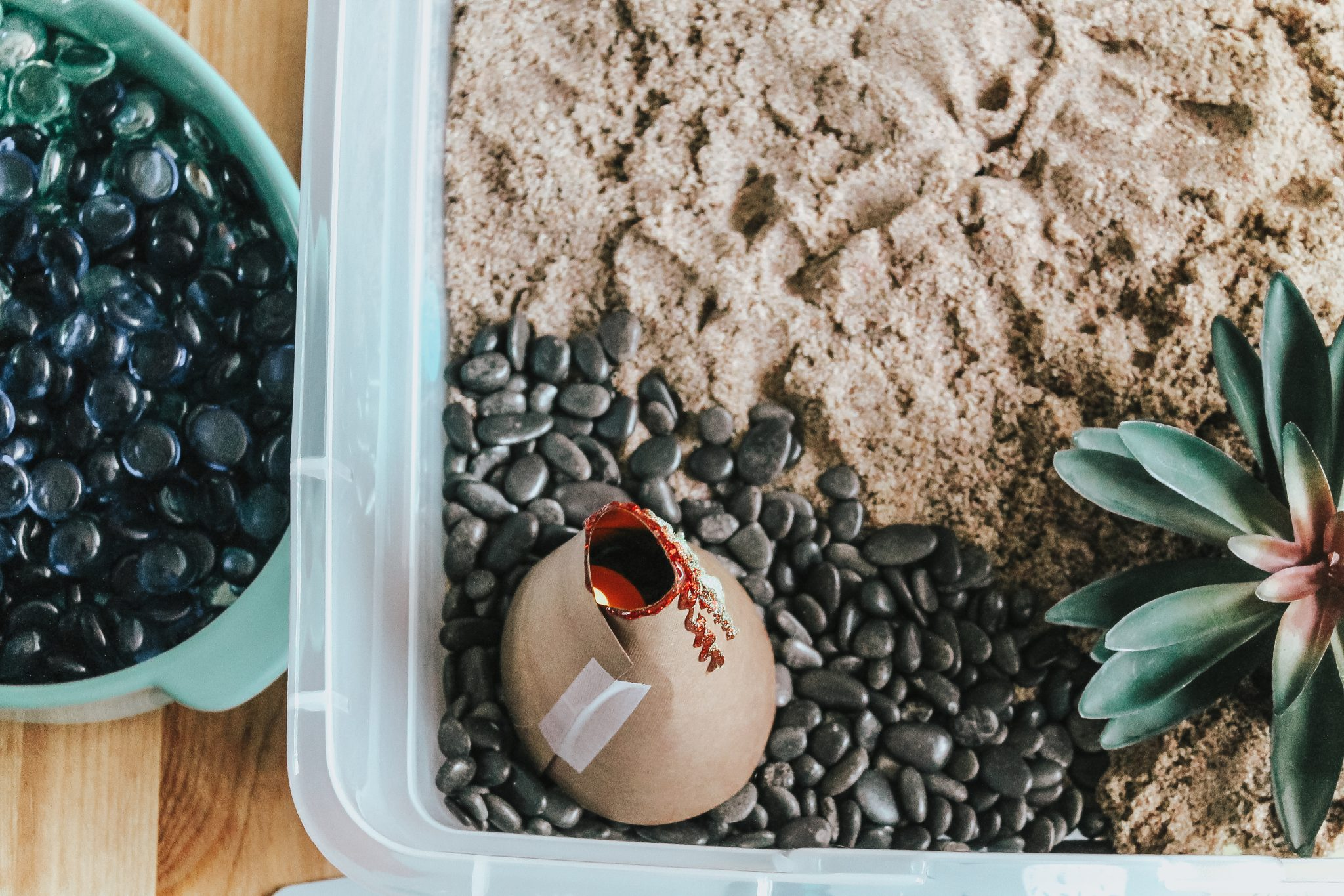 Dinosaur Island Sensory Bin with Kinetic Sand