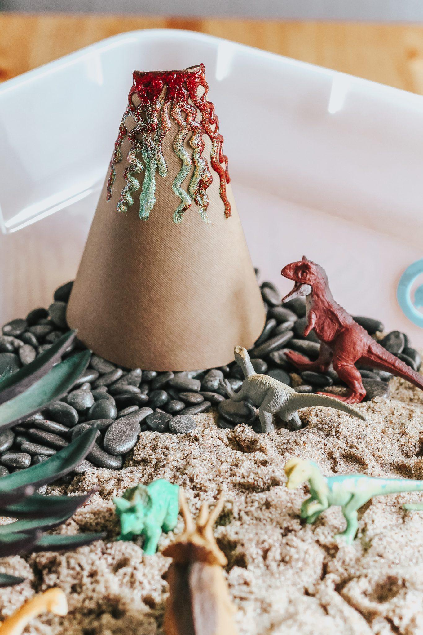 Dinosaur Island Sensory Bin with Kinetic Sand